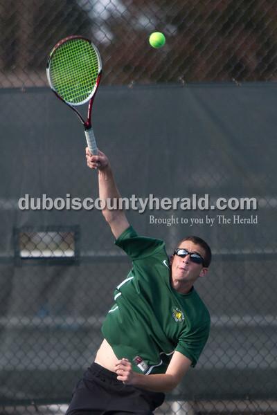 Forest Park's David Lusk served during Wednesday's tennis sectional against Jasper in Jasper. Ariana van den Akker/The Herald