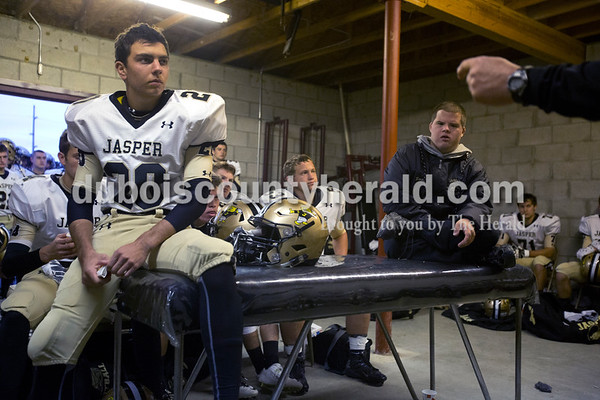 Erica Lafser/The Herald Jasper's Adam Betz, left, listened to Head Coach Tony Ahrens speech before Friday night's game against Mount Carmel in Mount Carmel. The Wildcats won 43-22.