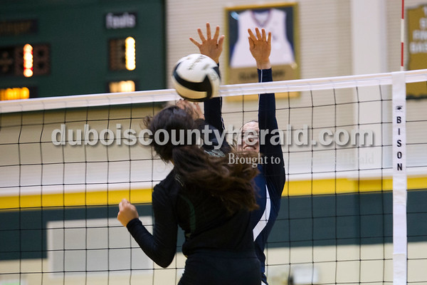 Forest Park's Katelyn Tretter spiked the ball as Heritage Hills' Abby Wahl jumped to block during Monday night's game at Forest Park High School in Ferdinand. Heritage Hills won in three sets.  Alisha Jucevic/The Herald
