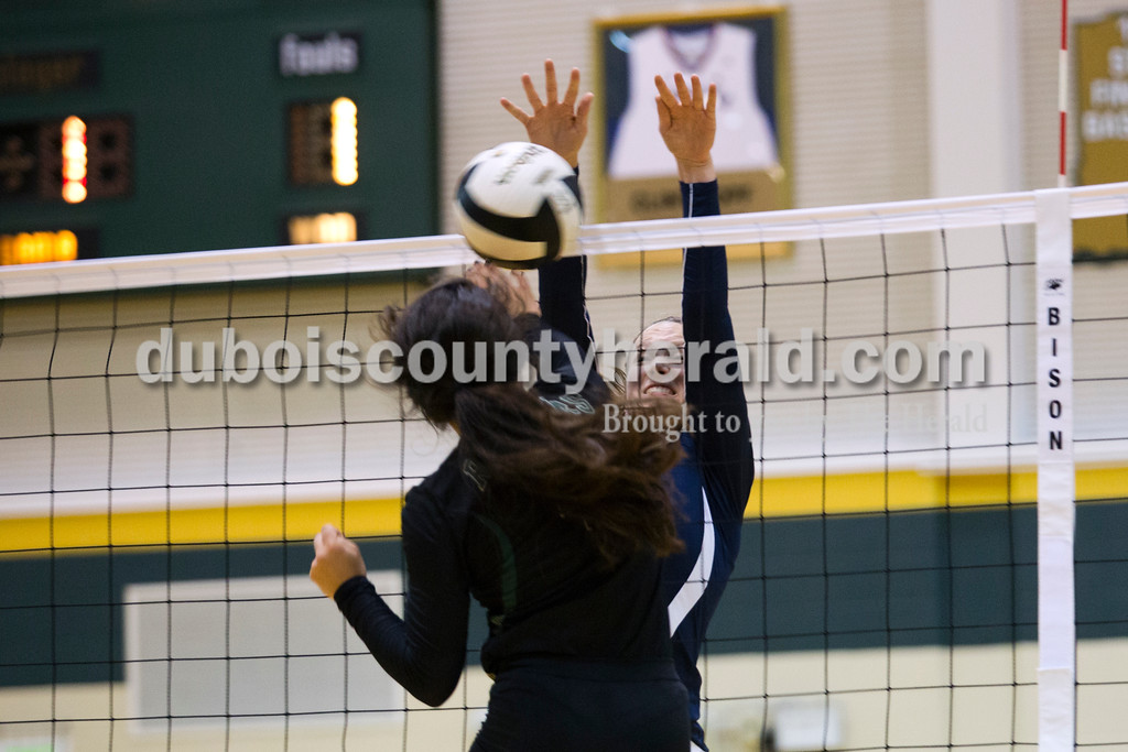 Forest Park's Katelyn Tretter spiked the ball as Heritage Hills' Abby Wahl jumped to block during Monday night's game at Forest Park High School in Ferdinand. Heritage Hills won in three sets. <br /> Alisha Jucevic/The Herald