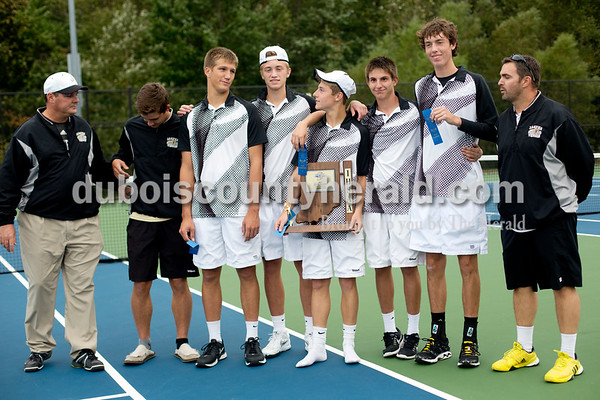 Jasper seniors Brandon Sizemore, second from left, Alex Allen, Hudson Schmidt, Jo Kemker, Henry Love and Logan Mathies lined up with the sectional trophy after winning Thursday's tennis sectional championship against Pike Central in Jasper. Jasper won 5-0. Ariana van den Akker/The Herald