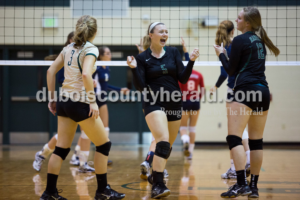 Forest Park's Madi Giesler celebrated after a point during Monday night's game at Forest Park High School in Ferdinand. Heritage Hills won in three sets. <br /> Alisha Jucevic/The Herald