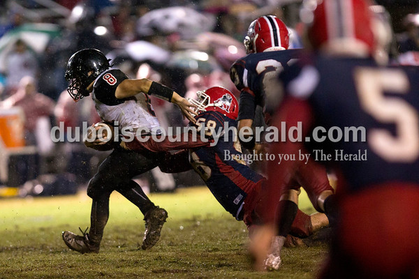 Heritage Hills' Zach Durham brought down Southridge's Tucker Schank during Friday night's game in Lincoln City. Heritage Hills defeated Southridge 17-7.   Alisha Jucevic/The Herald