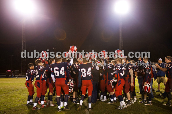 The Heritage Hills Patriots raised their helmets in celebration after Friday night's game in Lincoln City. Heritage Hills defeated Southridge 17-7.   Alisha Jucevic/The Herald