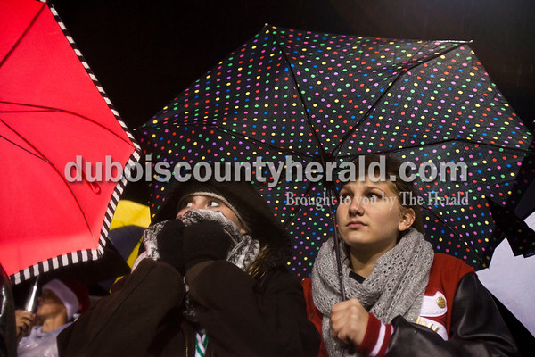Southridge High School seniors Mallory Peter and Kayla Voegerl watched Friday night's game against Heritage Hills in Lincoln City. Heritage Hills defeated Southridge 17-7.   Alisha Jucevic/The Herald