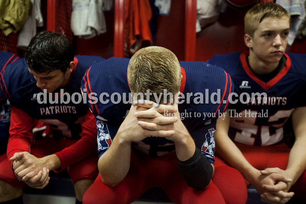 Heritage Hills' Gabe Hitz, Beau Harpenau and Matthew Graham gathered their thoughts before Friday night's game against Southridge  in Lincoln City. Heritage Hills defeated Southridge 17-7.   Alisha Jucevic/The Herald
