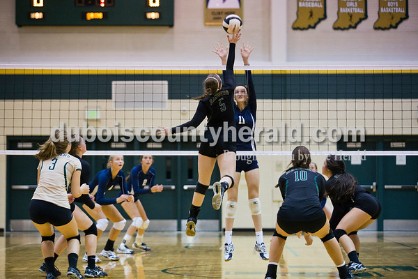 Forest Park's Madi Giesler spiked the ball as Heritage Hills' Jessica Bertke jumped to block during Monday night's game at Forest Park High School in Ferdinand. Heritage Hills won in three sets.  Alisha Jucevic/The Herald