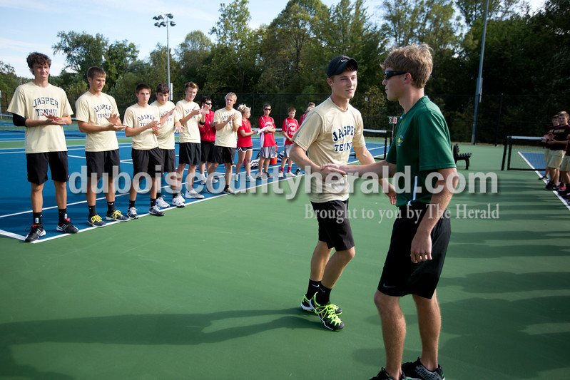 Jasper's Jo Kemker and Forest Park's Blake Emmert shook hands before Wednesday afternoon's tennis sectional in Jasper. Ariana van den Akker/The Herald