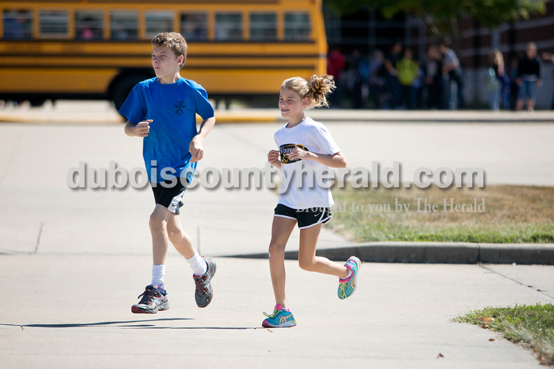 Ariana van den Akker/The Herald<br /> Jasper Middle School seventh-grader Kyle Allen, left, and sixth-grader Kiersten Wagner warmed up together at cross country practice after school on Tuesday. Kyle and Kiersten both have cerebral palsy and have formed a sort of running partnership for practices.