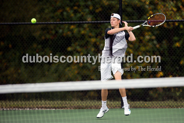 Jasper's Jo Kemker hit the ball during Thursday's tennis sectional championship against Pike Central in Jasper. Jasper won 5-0. Ariana van den Akker/The Herald