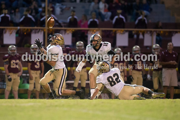 Erica Lafser/The Herald Jasper's Jace Durcholz, left, intercepted a pass intended for a Mount Carmel player during Friday night's game in Mount Carmel. The Wildcats won 43-22.