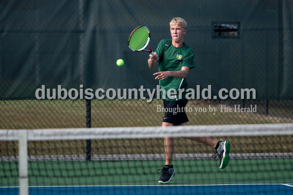 Forest Park's Zach Wendholt returned the ball during Wednesday's tennis sectional against Jasper in Jasper. Ariana van den Akker/The Herald