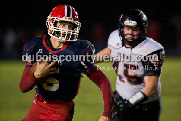 Heritage Hills' Kenton Crews outran Southridge's Chad Meyer during Friday night's game in Lincoln City. Heritage Hills defeated Southridge 17-7.   Alisha Jucevic/The Herald