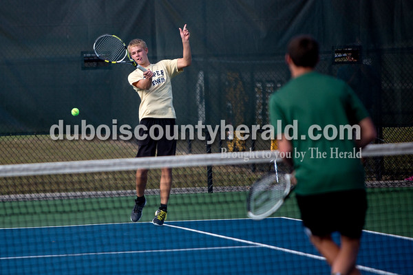 Jasper's Andrew Schmitt kept his eye on the ball during Wednesday's tennis sectional against Forest Park in Jasper. Ariana van den Akker/The Herald