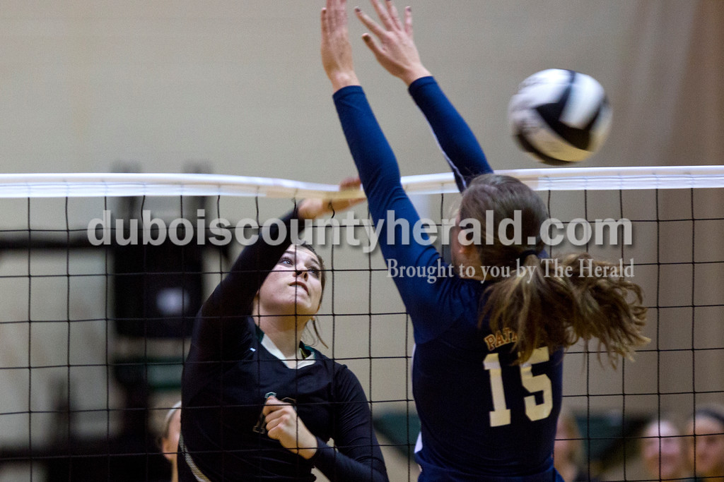 Forest Park's Karissa Wollenmann spiked the ball over the net as Heritage Hills' Abby Wahl jumped up to block during Monday night's game at Forest Park High School in Ferdinand. Heritage Hills won in three sets. <br /> Alisha Jucevic/The Herald