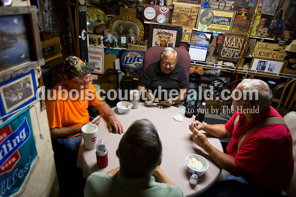 "Dan Schitter, left, Gib Voegerl, Dennis Rohleder, all of Jasper, and Dave Burger of Huntingburg played cards on Tuesday morning in Rohleder's ""man cave"" at his home in Jasper. Rohleder has invited friends over to play cards every week for the past six years. ""We sit here and try to solve all the problems in the world,"" Schitter chuckled.   Alisha Jucevic/The Herald"