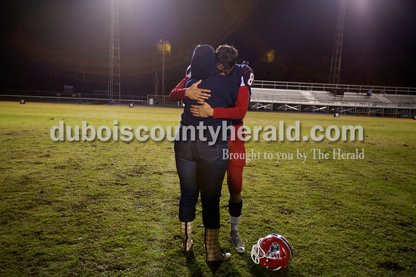 Lana Harpenau of Santa Claus embraced Heritage Hills' Gabe Hitz after Friday night's game in Lincoln City. Hitz's father passed away last week, and many of Hitz's friends and family came to support him during this game. Heritage Hills defeated Southridge 17-7.   Alisha Jucevic/The Herald