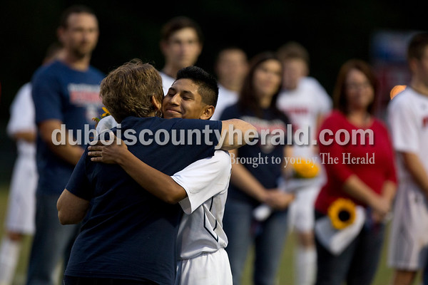 Erica Lafser/The Herald Heritage Hills' Isaac Scott hugged his mother during the Senior Night celebration at halftime during Tuesday night's game against Northeast Dubois at Heritage Hills in Lincoln City. The Patriots won 6-0.