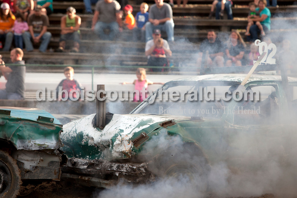 Erica Lafser/The Herald<br /> Greg Gerber of Winslow's car sent smoke throughout the arena during the demolition derby on Saturday at the Dubois County 4-H Fairgrounds. Gerber placed second in the mini-stock class.