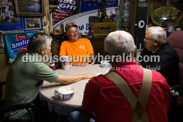 "Dave Burger of Huntingburg, left, Dan Schitter, center, Gib Voegerl, right, and Dennis Rohleder, bottom center, all of Jasper, played cards on Tuesday morning in Rohleder's ""man cave"" at his home in Jasper. Rohleder has invited friends over to play cards every week for the past six years. ""We sit here and try to solve all the problems in the world,"" Schitter chuckled.   Alisha Jucevic/The Herald"