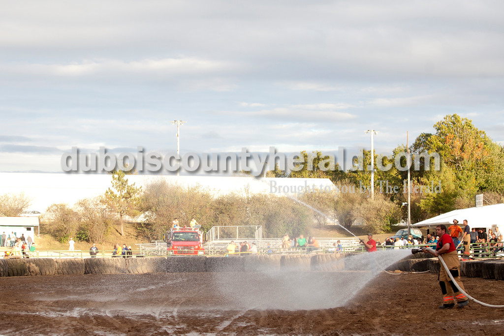 Erica Lafser/The Herald<br /> Nick Merkley of St. Anthony watered the course to give the cars more traction between classes of the demolition derby on Saturday at the Dubois County 4-H Fairgrounds.