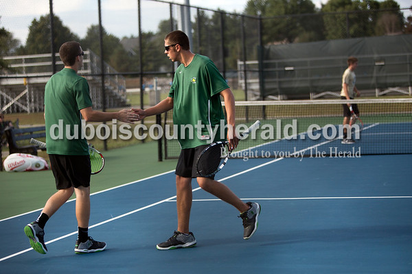 Forest Park's David Lusk, left, and Matthew Nonte celebrated a point during Wednesday's tennis sectional against Jasper in Jasper. Ariana van den Akker/The Herald