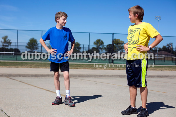 Ariana van den Akker/The Herald Jasper Middle School seventh-graders Kyle Allen, left, and Blake Danzer, joked about Danzer's shirt at cross country practice after school on Tuesday.