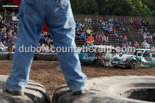 Erica Lafser/The Herald Corey Cox of Winslow, left, and Greg Gerber of Winslow collided during the demolition derby on Saturday at the Dubois County 4-H Fairgrounds. Cox placed first and Gerber placed second, both in the mini-stock class.