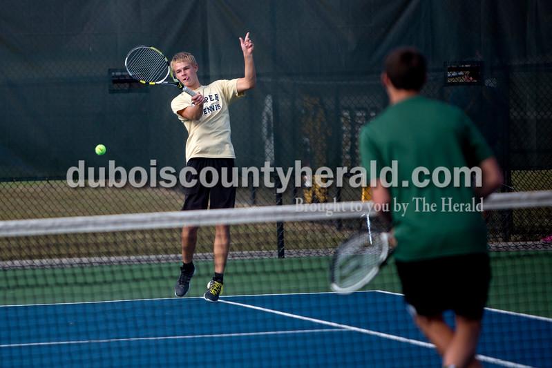 Jasper's Andrew Schmitt kept his eye on the ball during Wednesday's tennis sectional against Forest Park in Jasper. Ariana van den Akker/The Herald