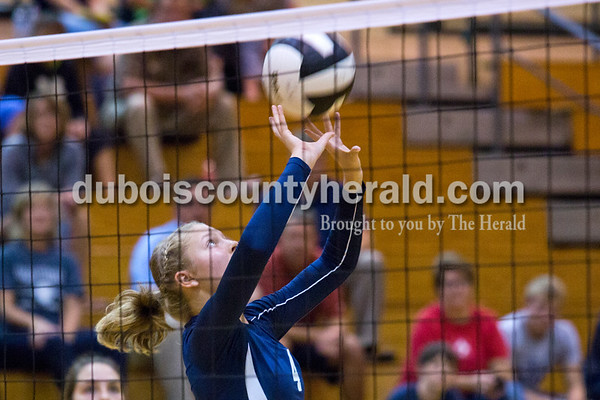 Heritage Hills' Abby Wetzel set the ball during Monday night's game at Forest Park High School in Ferdinand. Heritage Hills won in three sets.  Alisha Jucevic/The Herald