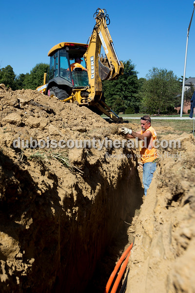 "Ariana van den Akker/The Herald Brian Redman, front, and Carl Leonard, both of Mitchell, buried line on Monday for new high speed internet service that will turn Jasper into a ""gigabtye"" city. The crew was working on the corner of St. Charles Street and Pleasant View Drive."