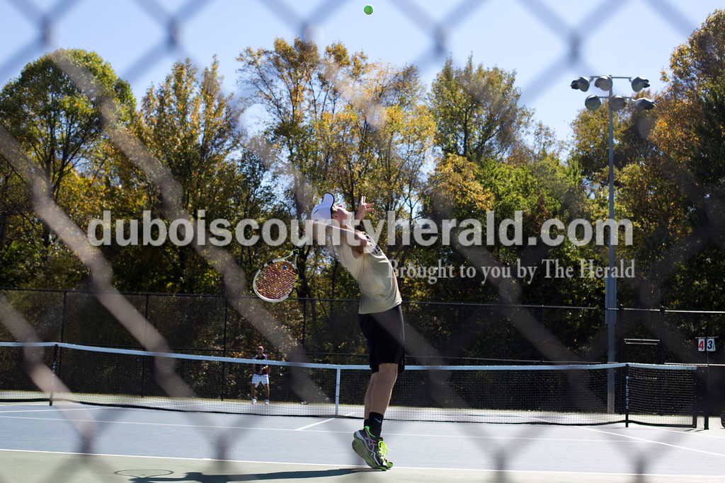 Erica Lafser/The Herald<br /> Jo Kemker served in his singles match during Saturday's semistate against Bloomington North at Jasper. The Wildcat's won 3-2, advancing them to state finals for the fifth straight season.