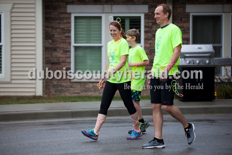 Alisha Jucevic/The Herald <br /> Becky Hopf and her husband Glen, and son Carter, 12, all of Jasper, started the Illuminating Life 5k walk and run put on by Miss Indiana Sr. Sweetheart 2016, Priscilla Olson of Jasper, 16, on Saturday evening at Northwood Retirement Community in Jasper.