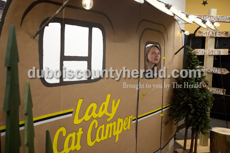 Erica Lafser/The Herald<br /> Jasper's former volleyball player, now an IU freshman, admired the locker room decorations before Tuesday night's Class 3A regional championship against Mount Vernon at Jasper High School. The Wildcat's won in three games.