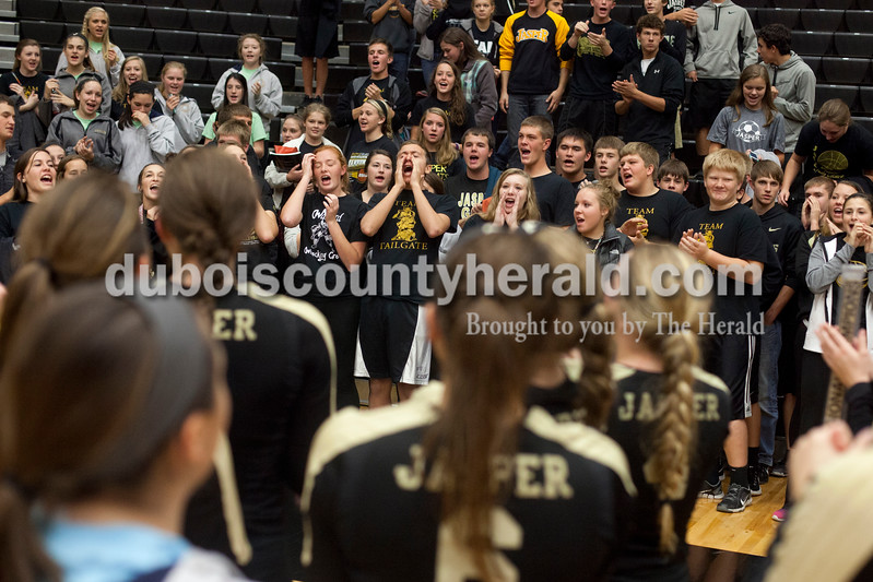 Erica Lafser/The Herald<br /> Jasper's student section and volleyball team came together to sing their school song after Tuesday night's Class 3A regional championship against Mount Vernon at Jasper High School. The Wildcat's won in three games.