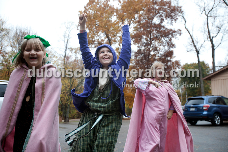 Erica Lafser/The Herald<br /> Lexi Murphy of Owensboro, 9, left, and her sister Autumn, 10, right, cheered for the piñata on both sides of Mavin Singer of Lafayette, 8, on Saturday during the 26th annual Rendezvous at the Bridge hosted by Shire of Riviere Constelle at Lincoln State Park in Lincoln City. This Evansville chapter of the international Society for Anachronism's event included activities such as tournaments with medieval fighting, arts and science competitions and classes, and a six-course meal.