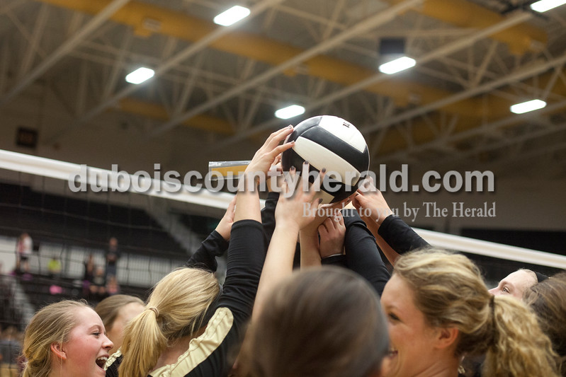 Erica Lafser/The Herald<br /> Jasper's volleyball team held up their ball and new regional champion plaque after Tuesday night's Class 3A regional championship against Mount Vernon at Jasper High School. The Wildcat's won in three games.