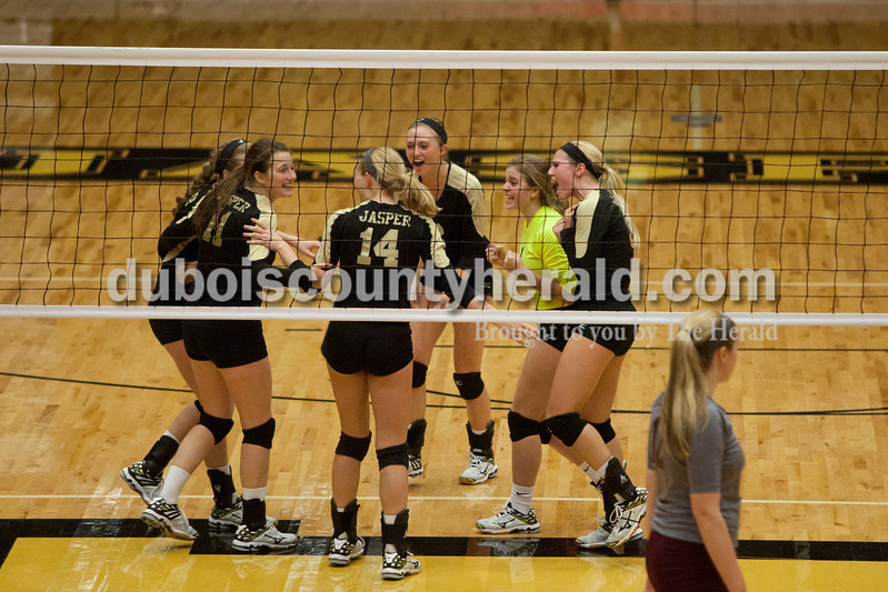 Erica Lafser/The Herald<br /> Jasper's volleyball team cheered on the court during Tuesday night's Class 3A regional championship against Mount Vernon at Jasper High School. The Wildcat's won in three games.