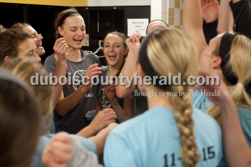 Erica Lafser/The Herald<br /> Jasper's volleyball team huddled for a cheer in the locker rooms before Tuesday night's Class 3A regional championship against Mount Vernon at Jasper High School. The Wildcat's won in three games.