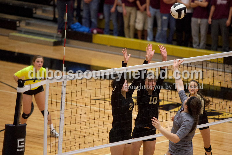 Erica Lafser/The Herald<br /> Jasper's Maddie Edwards, left, and Avery Bell defended the net against a Mount Vernon's player during Tuesday night's Class 3A regional championship at Jasper High School. The Wildcat's won in three games.