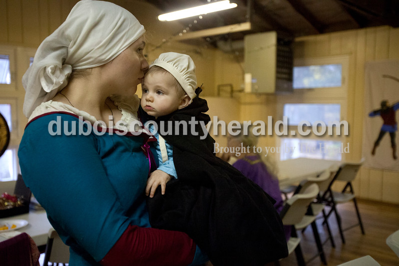 Erica Lafser/The Herald<br /> Hannah Morrissey of Hymera kissed her 7-month-old daughter, Catalina, on Saturday during the 26th annual Rendezvous at the Bridge hosted by Shire of Riviere Constelle at Lincoln State Park in Lincoln City. This Evansville chapter of the international Society for Anachronism's event included activities such as tournaments with medieval fighting, arts and science competitions and classes, and a six-course meal.