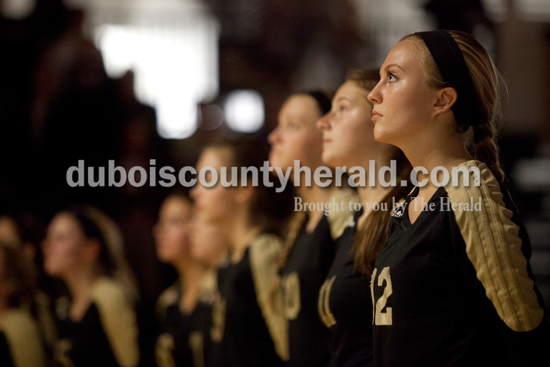 Erica Lafser/The Herald<br /> Jasper's Kinsey Bromm looked to the flag as the national anthem played before Tuesday night's Class 3A regional championship against Mount Vernon at Jasper High School. The Wildcat's won in three games.