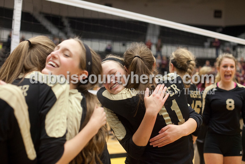 Erica Lafser/The Herald<br /> The Jasper volleyball team was overcome with excitement from defeating Mount Vernon on Tuesday in the Class 3A regional championship at Jasper High School. The Wildcat's won in three games.