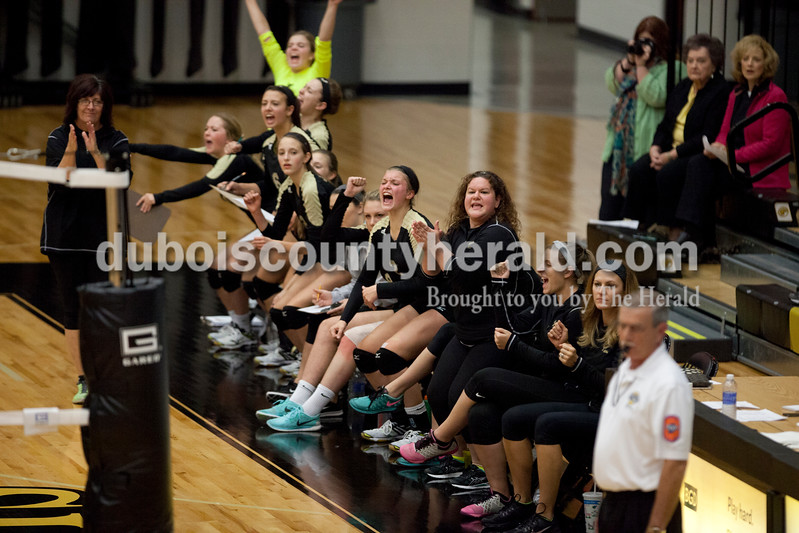 Erica Lafser/The Herald<br /> Jasper's sidelines erupted in cheers for well-earned points during Tuesday night's Class 3A regional championship against Mount Vernon at Jasper High School. The Wildcat's won in three games.