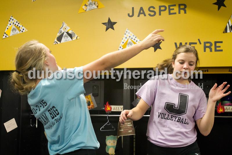 Erica Lafser/The Herald<br /> Jasper's Alyssa Collignon, left, and Layne Sermersheim danced in the locker rooms before Tuesday night's Class 3A regional championship against Mount Vernon at Jasper High School. The Wildcat's won in three games.
