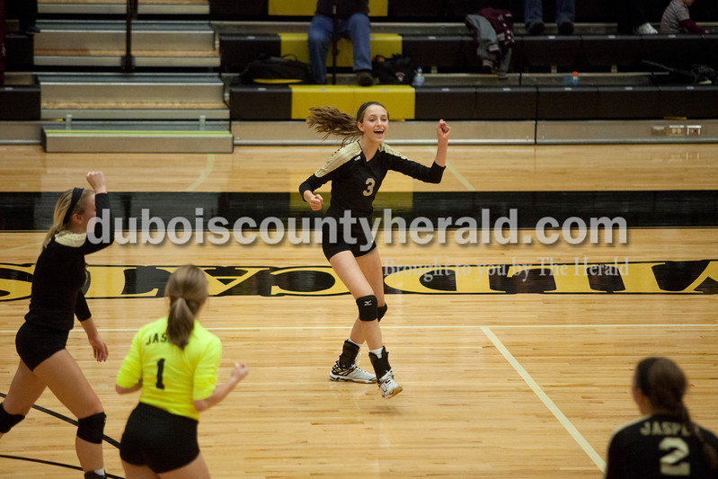 Erica Lafser/The Herald<br /> Jasper's Libby Bell turned to cheer with her teammates after they scored a point during Tuesday night's Class 3A regional championship against Mount Vernon at Jasper High School. The Wildcat's won in three games.
