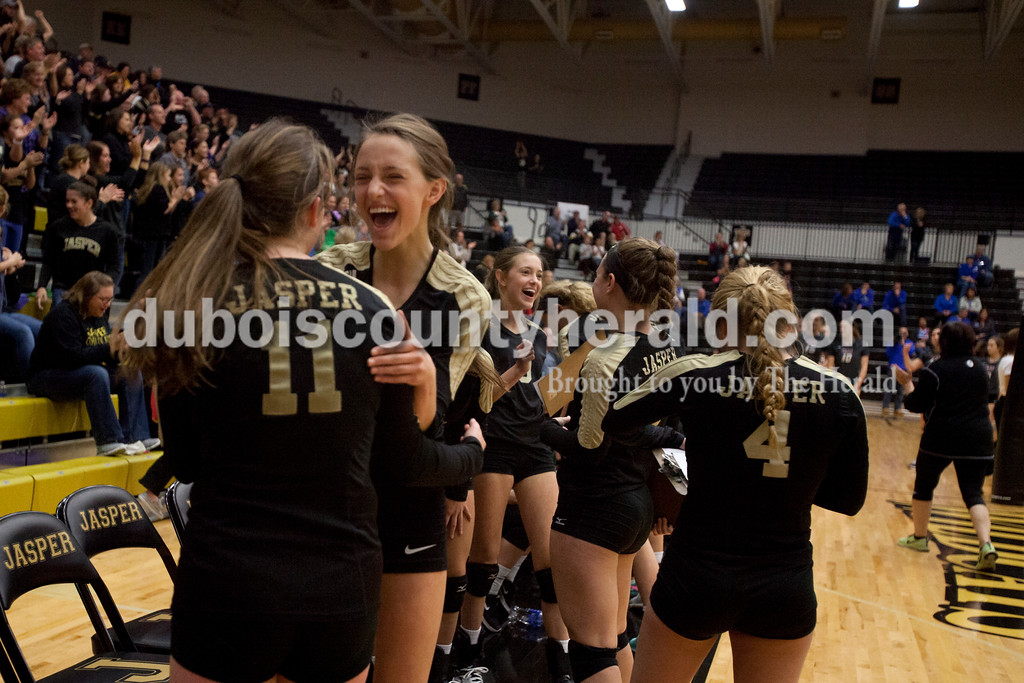 Erica Lafser/The Herald<br /> Jasper's Libby Bell ran up to Jocelynn Morrow in celebration of winning a set during Saturday's Class 3A semistate match against Northview at Jasper High School. The Wildcats' lost in four sets.