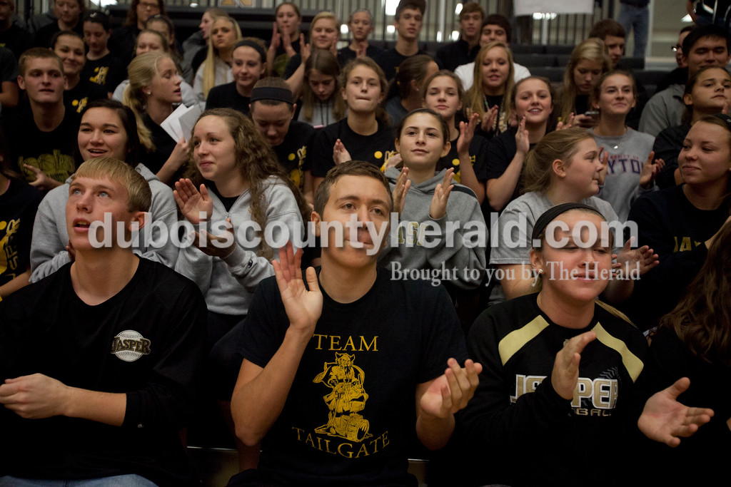 Erica Lafser/The Herald<br /> Jasper seniors Craig Shepherd, left, JohnPaul Luke and Nicolette Eckert cheered for their volleyball team during Saturday's Class 3A semistate match against Northview at Jasper High School. The Wildcats' lost in four sets.