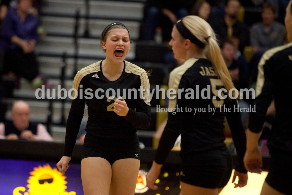 Erica Lafser/The Herald<br /> Jasper's Maddie Edwards cheered after they scored a point during Saturday's Class 3A semistate match against Northview at Jasper High School. The Wildcats' lost in four sets.