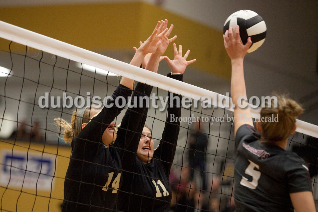 Erica Lafser/The Herald<br /> Jasper's Teyah Leinenbach, left, and Jocelynn Morrow defended the net from Northview's Madison McDonald during Saturday's Class 3A semistate match at Jasper High School. The Wildcats' lost in four sets.